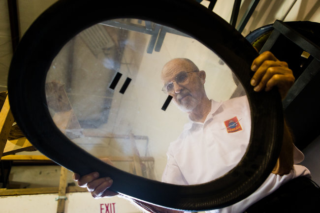 Mr. Enevoldson with one of the glider's windows. The cabin will be sealed as the plane climbs.