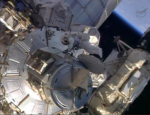 NASA spacewalker Mike Hopkins works outside the International Space Station on Saturday.