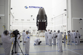 Members of the news media are given an opportunity for an up-close look at the TDRS-L spacecraft undergoing preflight processing inside the Astrotech payload processing facility in Titusville ahead of the satellite's January 2014 launch.